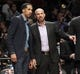 Apr 13, 2014; Brooklyn, NY, USA; Brooklyn Nets head coach Jason Kidd (right) reacts with guard Shaun Livingston (left) in the second quarter against Orlando Magic at Barclays Center. Nets win 97-88. Mandatory Credit: Nicole Sweet-USA TODAY Sports