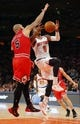 Apr 13, 2014; New York, NY, USA;  New York Knicks guard J.R. Smith (8) drives to the basket during the second half against Chicago Bulls forward Carlos Boozer (5) at Madison Square Garden. New York Knicks defeat the Chicago Bulls 100-89. Mandatory Credit: Jim O'Connor-USA TODAY Sports