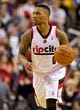 Apr 13, 2014; Portland, OR, USA; Portland Trail Blazers guard Damian Lillard (0) brings the ball up court against the Golden State Warriors during the second quarter at the Moda Center. Mandatory Credit: Craig Mitchelldyer-USA TODAY Sports