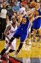 Apr 13, 2014; Portland, OR, USA; Golden State Warriors guard Stephen Curry (30) saves the ball from going over and back in front of Portland Trail Blazers guard Wesley Matthews (2) during the third quarter at the Moda Center. Mandatory Credit: Craig Mitchelldyer-USA TODAY Sports