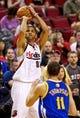 Apr 13, 2014; Portland, OR, USA; Portland Trail Blazers forward Nicolas Batum (88) shoots over Golden State Warriors guard Klay Thompson (11) during the third quarter at the Moda Center. Mandatory Credit: Craig Mitchelldyer-USA TODAY Sports
