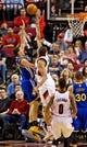 Apr 13, 2014; Portland, OR, USA; Golden State Warriors guard Klay Thompson (11) shoots over Portland Trail Blazers forward Nicolas Batum (88) during the third quarter at the Moda Center. Mandatory Credit: Craig Mitchelldyer-USA TODAY Sports