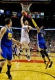 Apr 13, 2014; Portland, OR, USA; Portland Trail Blazers center Robin Lopez (42) dunks over Golden State Warriors forward Andre Iguodala (9) during the fourth quarter at the Moda Center. Mandatory Credit: Craig Mitchelldyer-USA TODAY Sports