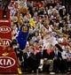 Apr 13, 2014; Portland, OR, USA; Golden State Warriors forward Andre Iguodala (9) shoots over Portland Trail Blazers guard Damian Lillard (0) during the fourth quarter at the Moda Center. Mandatory Credit: Craig Mitchelldyer-USA TODAY Sports