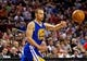 Apr 13, 2014; Portland, OR, USA; Golden State Warriors guard Stephen Curry (30) passes against the Portland Trail Blazers during overtime at the Moda Center. Mandatory Credit: Craig Mitchelldyer-USA TODAY Sports
