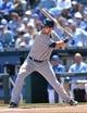 Apr 9, 2014; Kansas City, MO, USA; Tampa Rays second basemen Ben Zobrist (18) at bat against the Kansas City Royals during the first inning at Kauffman Stadium. Mandatory Credit: Peter G. Aiken-USA TODAY Sports