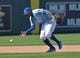 Apr 9, 2014; Kansas City, MO, USA; Kansas City Royals shortstop Alcides Escobar (2) fields a ground ball bare handed against the Tampa Bay Rays during the ninth inning at Kauffman Stadium. Mandatory Credit: Peter G. Aiken-USA TODAY Sports