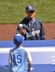 Apr 9, 2014; Kansas City, MO, USA; Tampa Rays pitcher Chris Archer (22) tosses a ball to a young boy during the third inning against the Kansas City Royals at Kauffman Stadium. Mandatory Credit: Peter G. Aiken-USA TODAY Sports