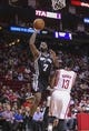 Apr 14, 2014; Houston, TX, USA; San Antonio Spurs forward Damion James (7) shoots during the first quarter as Houston Rockets guard James Harden (13) defends at Toyota Center. Mandatory Credit: Troy Taormina-USA TODAY Sports