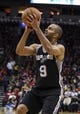 Apr 14, 2014; Houston, TX, USA; San Antonio Spurs guard Tony Parker (9) shoots during the second quarter against the Houston Rockets at Toyota Center. Mandatory Credit: Troy Taormina-USA TODAY Sports