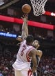 Apr 14, 2014; Houston, TX, USA; San Antonio Spurs forward Tim Duncan (21) shoots during the second quarter as Houston Rockets forward Terrence Jones (6) defends at Toyota Center. Mandatory Credit: Troy Taormina-USA TODAY Sports