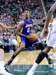 Apr 14, 2014; Salt Lake City, UT, USA; Los Angeles Lakers forward Nick Young (0) looks to shoot during the first half against the Utah Jazz at EnergySolutions Arena. Mandatory Credit: Russ Isabella-USA TODAY Sports