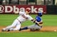 Apr 14, 2014; Phoenix, AZ, USA; Arizona Diamondbacks second baseman Aaron Hill (2) dives for and misses catching a ball as New York Mets left fielder Eric Young Jr. (22) slides to steal second base during the first inning at Chase Field. Mandatory Credit: Matt Kartozian-USA TODAY Sports