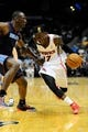 Apr 14, 2014; Atlanta, GA, USA; Atlanta Hawks guard Dennis Schroder (17) drives to the basket against Charlotte Bobcats center Bismack Biyombo (0) during the second half at Philips Arena. The Bobcats defeated the Hawks 95-93. Mandatory Credit: Dale Zanine-USA TODAY Sports