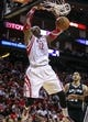 Apr 14, 2014; Houston, TX, USA; Houston Rockets center Dwight Howard (12) dunks the ball during the third quarter against the San Antonio Spurs at Toyota Center. The Rockets defeated the Spurs 104-98. Mandatory Credit: Troy Taormina-USA TODAY Sports