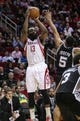 Apr 14, 2014; Houston, TX, USA; Houston Rockets guard James Harden (13) shoots during the fourth quarter against the San Antonio Spurs at Toyota Center. The Rockets defeated the Spurs 104-98. Mandatory Credit: Troy Taormina-USA TODAY Sports