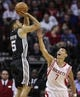Apr 14, 2014; Houston, TX, USA; San Antonio Spurs guard Cory Joseph (5) shoots during the fourth quarter as Houston Rockets guard Jeremy Lin (7) defends at Toyota Center. The Rockets defeated the Spurs 104-98. Mandatory Credit: Troy Taormina-USA TODAY Sports