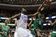 Apr 14, 2014; Philadelphia, PA, USA; Boston Celtics forward Jeff Green (8) grabs a rebound from Philadelphia 76ers center Henry Sims (35) in the fourth quarter of the game at Wells Fargo Center. The Philadelphia 76ers won 113-108. Mandatory Credit: John Geliebter-USA TODAY Sports
