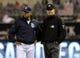 Apr 14, 2014; San Diego, CA, USA; San Diego Padres manager Bud Black (20) questions a call by first base umpire Jeff Nelson (right) during the third inning against the Colorado Rockies at Petco Park. Mandatory Credit: Christopher Hanewinckel-USA TODAY Sports
