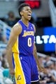 Apr 14, 2014; Salt Lake City, UT, USA; Los Angeles Lakers forward Nick Young (0) reacts during the second half against the Utah Jazz at EnergySolutions Arena. The Lakers won 119-104. Mandatory Credit: Russ Isabella-USA TODAY Sports