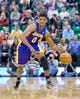 Apr 14, 2014; Salt Lake City, UT, USA; Los Angeles Lakers forward Nick Young (0) dribbles the ball during the second half at EnergySolutions Arena. The Lakers won 119-104. Mandatory Credit: Russ Isabella-USA TODAY Sports