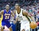 Apr 14, 2014; Salt Lake City, UT, USA; Utah Jazz guard Alec Burks (10) dribbles the ball in front of Los Angeles Lakers guard Jodie Meeks (20) during the second half at EnergySolutions Arena. The Lakers won 119-104. Mandatory Credit: Russ Isabella-USA TODAY Sports