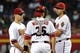 Apr 14, 2014; Phoenix, AZ, USA; Arizona Diamondbacks pitcher Mike Bolsinger (49) talks with catcher Miguel Montero (26) and second baseman Aaron Hill (2) during the fifth inning against the New York Mets at Chase Field. Mandatory Credit: Matt Kartozian-USA TODAY Sports