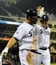 Apr 14, 2014; San Diego, CA, USA; San Diego Padres pinch hitter Xavier Nady (left) celebrates with left fielder Seth Smith (12) after scoring the tying and go ahead runs during the eighth inning against the Colorado Rockies at Petco Park. Mandatory Credit: Christopher Hanewinckel-USA TODAY Sports