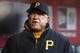 Apr 15, 2014; Cincinnati, OH, USA; Pittsburgh Pirates manager Clint Hurdle watches from the dugout before a game with the Cincinnati Reds at Great American Ball Park. Mandatory Credit: David Kohl-USA TODAY Sports