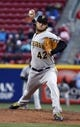 Apr 15, 2014; Cincinnati, OH, USA; Pittsburgh Pirates starting pitcher Gerrit Cole throws against the Cincinnati Reds during the first inning at Great American Ball Park. Mandatory Credit: David Kohl-USA TODAY Sports