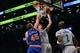 Apr 15, 2014; Brooklyn, NY, USA;  Brooklyn Nets forward Andrei Kirilenko (47) and New York Knicks center Cole Aldrich (45) battle at the net during the third quarter at Barclays Center. New York Knicks won 109-98.  Mandatory Credit: Anthony Gruppuso-USA TODAY Sports