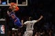 Apr 15, 2014; Brooklyn, NY, USA;  New York Knicks guard Iman Shumpert (21) dunks in front of Brooklyn Nets center Andray Blatche (0) during the fourth quarter at Barclays Center. New York Knicks won 109-98.  Mandatory Credit: Anthony Gruppuso-USA TODAY Sports