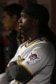 Apr 15, 2014; Cincinnati, OH, USA; Pittsburgh Pirates center fielder Andrew McCutchen watches from the dugout during a game against the Cincinnati Reds at Great American Ball Park. The Reds won 7-5. Mandatory Credit: David Kohl-USA TODAY Sports