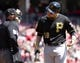 Apr 16, 2014; Cincinnati, OH, USA; Pittsburgh Pirates second baseman Neil Walker (18) has words with home plate umpire Quinn Wolcott (81) after striking out during the second inning at Great American Ball Park. Mandatory Credit: David Kohl-USA TODAY Sports