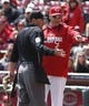 Apr 16, 2014; Cincinnati, OH, USA; Cincinnati Reds manager bryan Price, right, argues a call with home plate umpire Quin Wolcott, left, during the fifth inning at Great American Ball Park. The Reds won 4-0. Mandatory Credit: David Kohl-USA TODAY Sports
