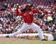 Apr 16, 2014; Cincinnati, OH, USA; Cincinnati Reds starting pitcher Johnny Cueto throws against the Pittsburgh Pirates during the eighth inning at Great American Ball Park. The Reds won 4-0. Mandatory Credit: David Kohl-USA TODAY Sports