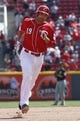 Apr 16, 2014; Cincinnati, OH, USA; Cincinnati Reds first baseman Joey Votto (19) rounds the bases after hitting a two-run home run off Pittsburgh Pirates starting pitcher Francisco Liriano during the seventh  inning at Great American Ball Park. The Reds won 4-0. Mandatory Credit: David Kohl-USA TODAY Sports