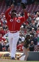 Apr 16, 2014; Cincinnati, OH, USA; Cincinnati Reds starting pitcher Johnny Cueto (47) points to the sky after he pitched a complete three-hit shutout game against the Pittsburgh Pirates at Great American Ball Park. The Reds won 4-0. Mandatory Credit: David Kohl-USA TODAY Sports