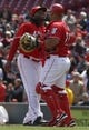 Apr 16, 2014; Cincinnati, OH, USA; Cincinnati Reds starting pitcher Johnny Cueto (47) is congratulated by catcher Brayan Pena (29) after the Reds defeated the Pittsburgh Pirates 4-0 at Great American Ball Park. Mandatory Credit: David Kohl-USA TODAY Sports