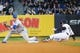 Apr 16, 2014; Bronx, NY, USA;  New York Yankees right fielder Carlos Beltran (36) slides safe on his double to left field as Chicago Cubs second baseman Darwin Barney (15) waits for the ball during the first inning  at Yankee Stadium. Mandatory Credit: Anthony Gruppuso-USA TODAY Sports