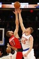 Apr 16, 2014; New York, NY, USA;  Toronto Raptors center Jonas Valanciunas (17) and New York Knicks center Cole Aldrich (45) tip off during the Knicks final game of the season at Madison Square Garden. Mandatory Credit: Jim O'Connor-USA TODAY Sports