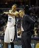 Apr 16, 2014; Memphis, TN, USA; Memphis Grizzlies forward Tayshaun Prince (21) talks to Memphis Grizzlies head coach David Joerger during the game against the Dallas Mavericks at FedExForum. Mandatory Credit: Justin Ford-USA TODAY Sports