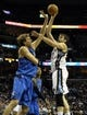 Apr 16, 2014; Memphis, TN, USA; Memphis Grizzlies center Marc Gasol (33) shoots over Dallas Mavericks forward Dirk Nowitzki (41) during the game at FedExForum. Mandatory Credit: Justin Ford-USA TODAY Sports