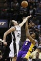 Apr 16, 2014; San Antonio, TX, USA; Los Angeles Lakers forward Nick Young (0) shoots the ball over San Antonio Spurs guard Manu Ginobili (20) during the second half at AT&T Center. Mandatory Credit: Soobum Im-USA TODAY Sports