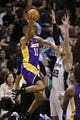Apr 16, 2014; San Antonio, TX, USA; Los Angeles Lakers forward Wesley Johnson (11) shoots the ball over San Antonio Spurs forward Tiago Splitter (22) during the first half at AT&T Center. Mandatory Credit: Soobum Im-USA TODAY Sports