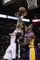 Apr 16, 2014; San Antonio, TX, USA; San Antonio Spurs guard Danny Green (left) shoots as Los Angeles Lakers forward Jordan Hill (27)  defends during the second half at AT&T Center. The Lakers won 113-100. Mandatory Credit: Soobum Im-USA TODAY Sports