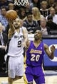 Apr 16, 2014; San Antonio, TX, USA; San Antonio Spurs guard Tony Parker (9) shoots the ball past Los Angeles Lakers guard Jodie Meeks (20) during the first half at AT&T Center. Mandatory Credit: Soobum Im-USA TODAY Sports