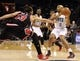 Apr 16, 2014; Charlotte, NC, USA; Charlotte Bobcats guard Gerald Henderson (9) looks to pass as he is defended by Chicago Bulls center Joakim Noah (13) during the second half of the game at Time Warner Cable Arena. Bobcats win in overtime 91-86. Mandatory Credit: Sam Sharpe-USA TODAY Sports