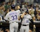 Apr 16, 2014; San Diego, CA, USA; Colorado Rockies first baseman Justin Morneau (33) is congratulated by second baseman Josh Rutledge (14) after a solo home run during the second inning against the San Diego Padres at Petco Park. Mandatory Credit: Christopher Hanewinckel-USA TODAY Sports