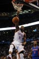 Apr 16, 2014; Oklahoma City, OK, USA;  Oklahoma City Thunder forward Serge Ibaka (9) dunks the ball against Detroit Pistons guard Kentavious Caldwell-Pope (5) during the fourth quarter at Chesapeake Energy Arena. Mandatory Credit: Mark D. Smith-USA TODAY Sports